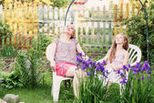 Daughter with her mother in the garden — Stock Photo