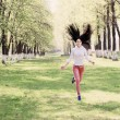 Beautiful girl jumping in park — Stock Photo #47940085