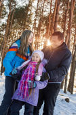 Happy family in winter forest — 图库照片
