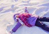 Happy child in a clear white snow — Stock Photo