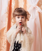 Little girl in shawl with lipstick — 图库照片