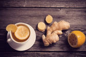 Ginger root with lemon and tea — Stock Photo
