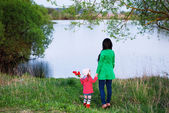 Woman and child over river — Stock Photo