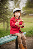 Little girl  with bagel — Stock Photo