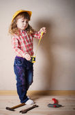 Little girl plays in the builder — Stock Photo