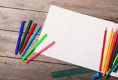 Paper and colorful pencils — Stock Photo
