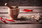 Mortar and pestle with peppers — Stock Photo