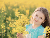 Smile girl in rape field — Stock Photo
