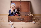 Baby playing with toy sailing boat indoors — Stock Photo