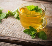 Cups of tea with mint on wooden — Stock Photo