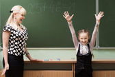 Schoolgirls and teacher in the classroom — Stock Photo
