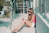 Teenage girl on her mobile phone — Stock Photo