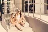 Two girls   with a teletphone — Stockfoto
