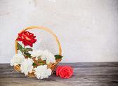 Roses in basket — Stock Photo
