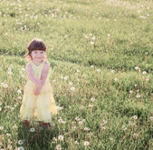 Little girl with dandelions — Stock Photo
