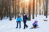 Happy family in winter forest — Stock Photo