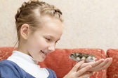 Little girl with gray hamster — Stock Photo