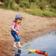 Smile child playing with paper boats in a river — Stock Photo #51155365