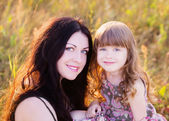 Mother and daughter outdoor — Stock Photo