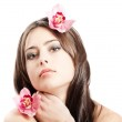 Beautiful woman with orchid — Stock Photo #9291204