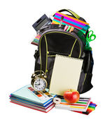 Schoolbag with supplies for education — Stock Photo