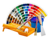 Plastic can with paint, roller, brushes — Stock Photo