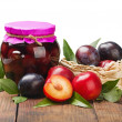 Ripe, fresh and canned plum — Stock Photo