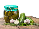 Fresh and canned pickles and garlic — Stock Photo