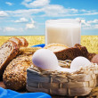 All baking homemade bread on the background of wheat field — Stock Photo