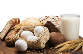 Milk, egg and wheat flour for bread — Stock Photo