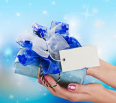 Blue gift in a female hand — Stok fotoğraf