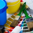 Brushes, rollers of paint rooms on the architectural plan - Stock Photo
