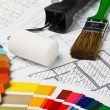 Stock Photo: Painting tools and accessories on architectural drawings.