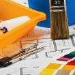 Stock Photo: Paints, brushes and accessories for repair to architectural draw