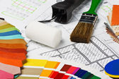 Painting tools and accessories on the architectural drawings. — Stock Photo