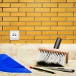 Stock Photo: Taping brick wall paper wallpaper and tools for repair