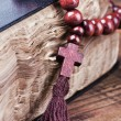 Wooden rosary on the Bible — Stock Photo