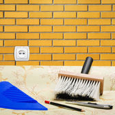 Taping a brick wall paper wallpaper and tools for repair — Stock Photo