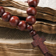 Stock Photo: Wooden rosary are on old bible