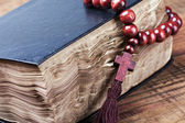 Open bible and wooden rosary — Stock Photo