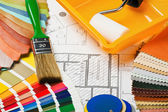 Paints, brushes and accessories for repair to architectural draw — Stock Photo