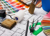 Brushes and accessories for repair to architectural drawing — Stock Photo