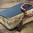 Wooden rosary and the Bible — Stock Photo