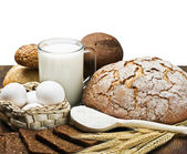 Fresh baked bread and ingredients for cooking — Stock Photo