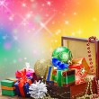 Christmas decorations, balloons and gifts in a wooden box — Stock Photo