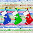 Christmas socks hung on a wooden color — Foto de Stock