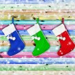 Christmas socks hung on a wooden color — Stock Photo
