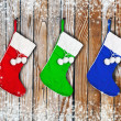 Christmas socks hanging on a wooden wall — Stock Photo