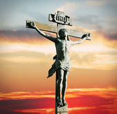 Crucifixion of Jesus Christ on the sunset — Stock Photo
