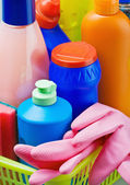 Various cleaning products and pink rubber gloves — Stock Photo